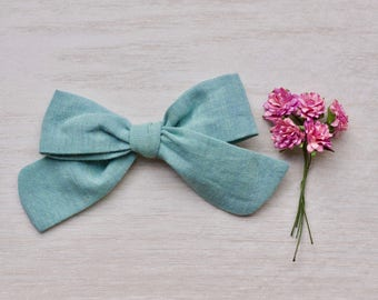 Tied bow (clip) • turquoise
