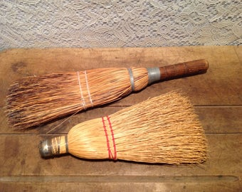 Set of two vintage hand whisk brooms