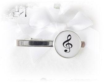 Tie clip, music note