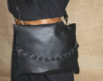 Black leather clutch with irregular flap