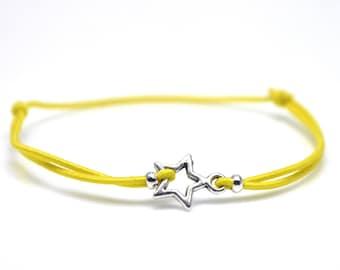 Silver star bracelet yellow cord