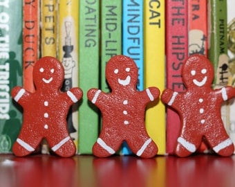 Wee Gingerbread Man brooches...can be clothed in a tartan kilt.