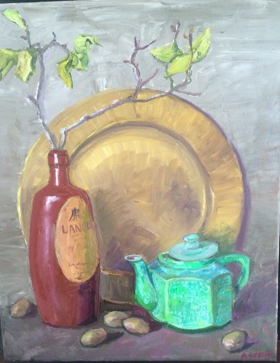 Still life Muted tones with gold dish, green tea kettle and Lancers vintage bottle with walnuts and green shrubery