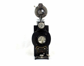 Steampunk Wine Bottle Stopper with black Stand - Vintage Kodak No. 2 Folding Camera
