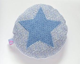 Blue and white round cushion
