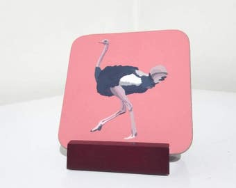 Four Ostrich wooden coaster set with stand on orange background