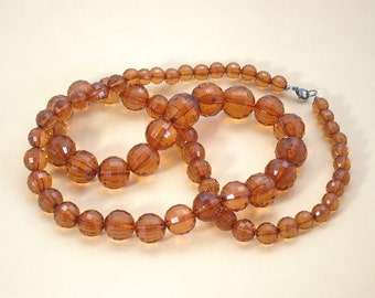Graduated brown plastic necklace, long necklace, faceted breads,