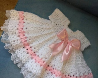 Crochet pink and white baby dress with lace ruffles