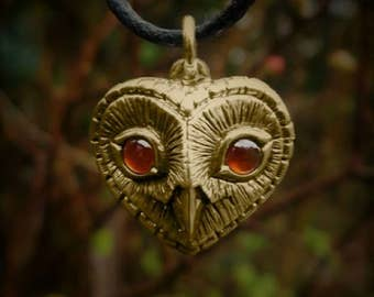 Gold owl necklace , solid gold and garnet heart shaped pendant.