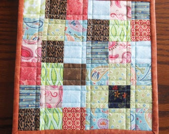 Quilted patchwork insulated pot holder, hot pad, trivet, candle mat, autumn tonings