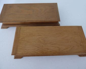 A pair of matching oak jewellery boxes