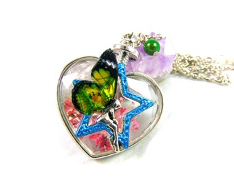 Silver heart pendant in glass with inclusion of dried flower with its fairy