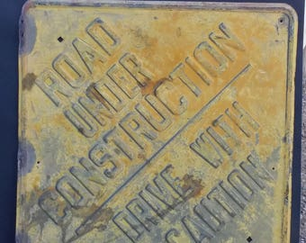 1940's Rusty yellow traffic safety Road Under Construction DRIVE WITH CAUTION sign embossed steel
