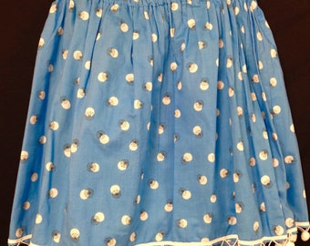 Skirt with pom poms