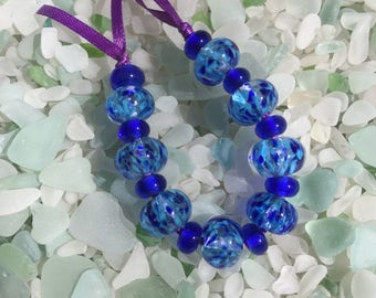 B'dazzled Encased Clear Glass Beads With Tiny Shades Of Blues In This Set Of Lampwork Beads