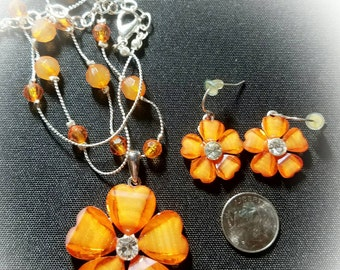 Vintage acrylic orange flower pendant necklace and matching earrings.