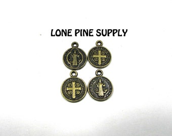3/8 Inch Round Antique Brass Christian Charms. Saint on One Side Cross on The Other. This is Saint Benedict.