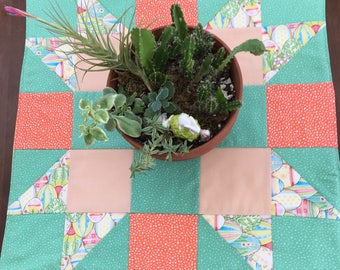 Spring table topper, 20 by 20 inches in bright pastels to brighten any room. All cotton,including batting, yellow backing.