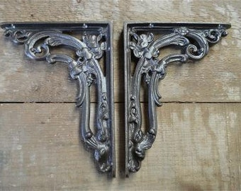 A pair of cast iron antique Victorian style foliage brackets AL19