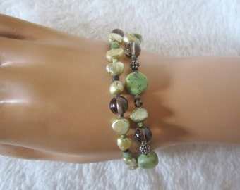 Bracelet- two strands with square toggle clasp. Vintage piece with 3 moss-green agate beads & pearl-like nuggets, glass beads. A great gift!