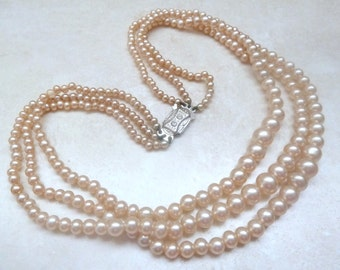Vintage Triple Stranded Faux Pearl Necklace With Ornate Fastener.