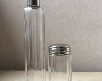 2 monogrammed silver topped old glass beauty bottles