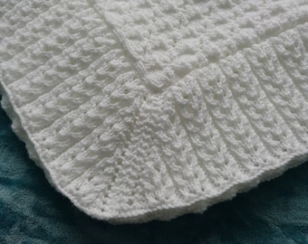 Hand knitted baby blanket or shawl in white DK yarn