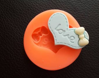 Silicone rubber mold written LOVE HEART with bow