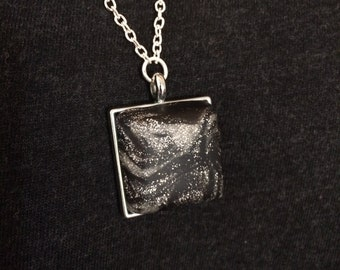 black and silver pendant necklace
