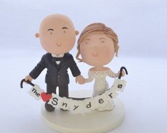 Couple holding with banner. Wedding cake topper. Wedding figurine. Bride and Groom. Handmade. Fully customizable. Unique keepsake