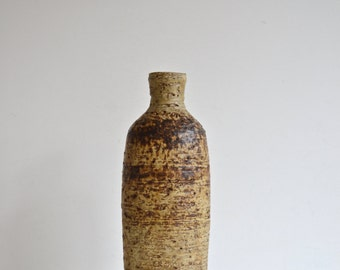 studio pottery stoneware handmade vase. unique centrepiece with soft and earthy tones and textures