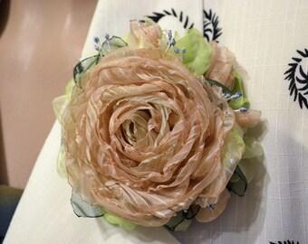 Brooch . Flower brooch . Rose brooch. Brooch textile. Brooch made of silk. The brooch is beige.