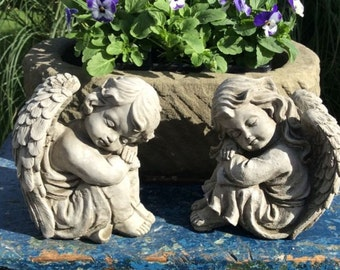 Pair of stone cherubs angels boy and girl