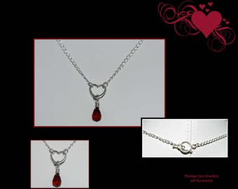 925 sterling silver necklace with heart/garnet pendant.