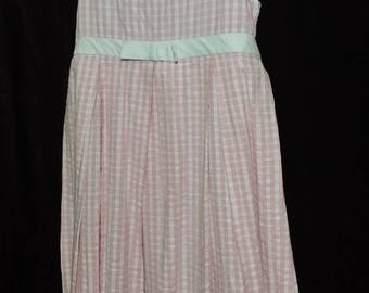 An adorable little girl, simple pink and  white check dress. size 6X