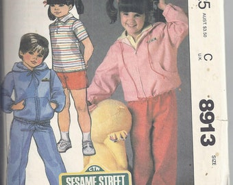McCall's 8913 Sewing Pattern from 1984.  Child's lined jacket, top, shorts and pants, A Sesame Street pattern. Chest/Breast 25
