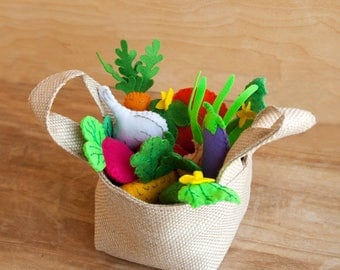 A set of felt vegetables in a shopping bag