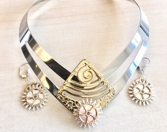 Ornament Sun of gold with silver bib necklace, gears, assorted loops