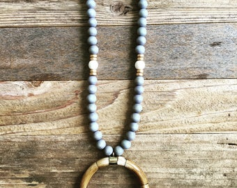 Grey Wood Beaded Necklace with White and Gold Accents and Brown Crescent Pendant