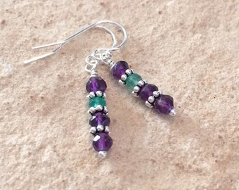 Purple and green earrings made with amethyst and peridot faceted beads, sterling silver daisy spacer beads and sterling silver ear wires