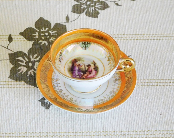 Featured listing image: Eggshell porcelain gold lusterware demitasse cup and saucer featuring two Regency ladies, made by ST Jlmia, vintage 1960s