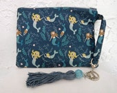 Mermaid-print wristlet pouch with purse charm - blue tassel, mermaid and seashell charms on keychain. Fun clutch or bag for phone/wallet.