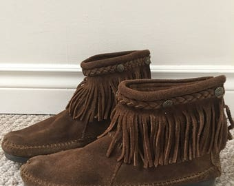 Minnetonka moccasin fringed brown suede rubber sole boho hippie ankle boots brass medallion accents   Festival wear size 9