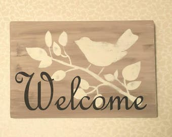 Welcome sign with Bird on Branch