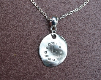 """Silver plated clock necklace. 12"""" chain."""