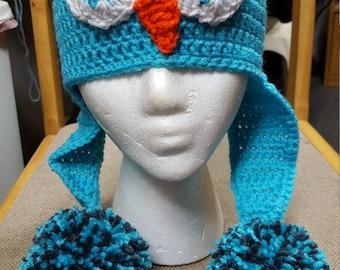 "Owl hat blue with 3"" pompoms"