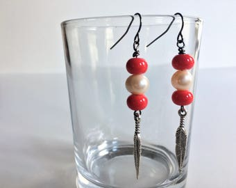 Pink and white pearl dangle earrings with feather accents