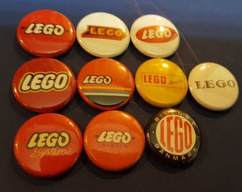 Lego Logo Pinback Button set 10 different Lego logos used through out the years Perfect for Lego collectors! buttons badges pin pins