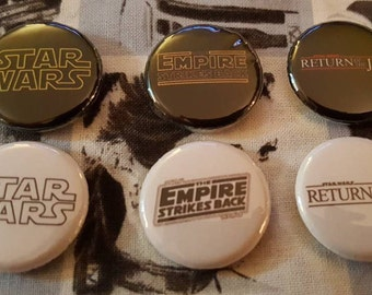 Set of 6 Star Wars pinback buttons badges pins featuring different Star Wars logos! Empire Strikes Back, Return of the Jedi! pin