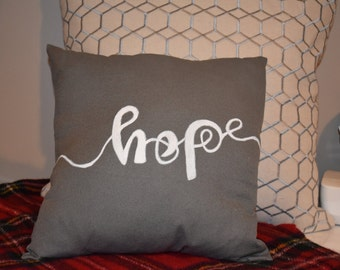 The Hope & Joy Pillow in charcoal